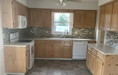 Spacious Kitchen With New Flooring